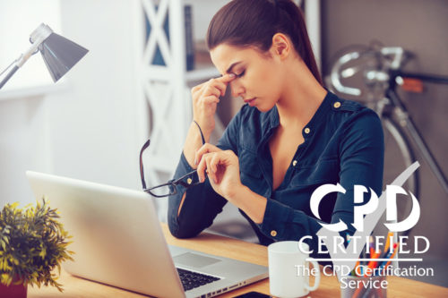 Stress-management-woman at laptop with headache